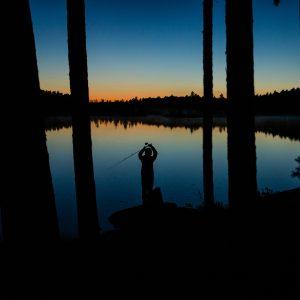 fishing girl at sunset
