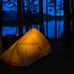 A orange tent sits on a dark night in BWCA by Bryan Bishop bb Image